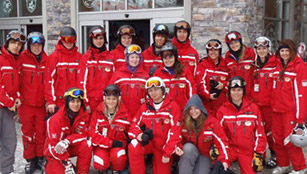 Group of training ski instructors with local ski school