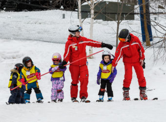 Ski instructors teaching beginners