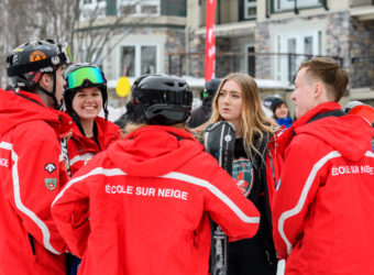 Ski instructors working as a team