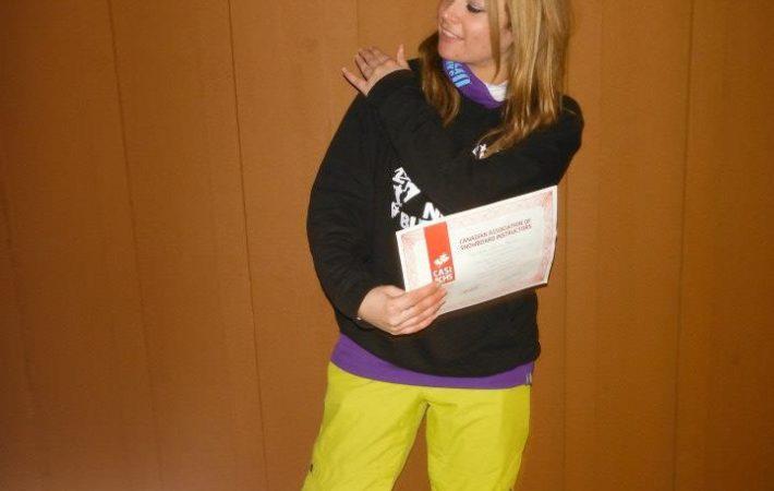 Joey passing her snowboard instructor exam